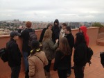 13_Students discuss building policies, social culture, and history with tour guide